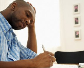 black-man-writing-285x229